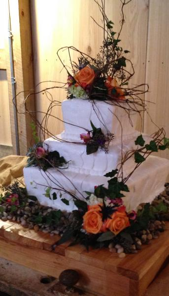 [Image: Not only do our wedding cakes taste great, they serve as perfect pieces of your ceremony.]