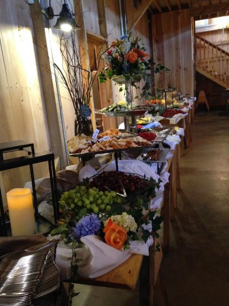 Make your serving tables, gift tables, and photo tables beautiful with flower arrangements that accentuate your venue and decor.]