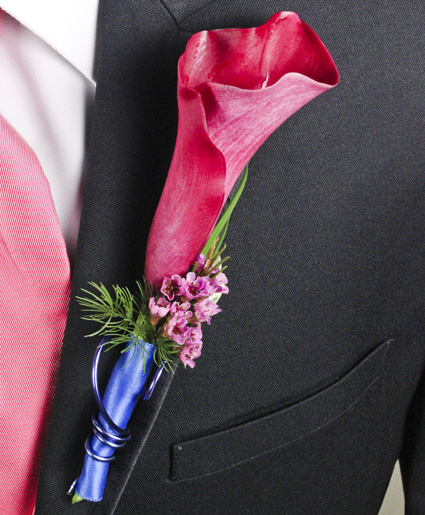 [Image: This prom boutonniere features a simple calla lily with hints of green, purple and blue ribbon and wire.]