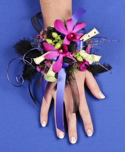 This prom corsage is so fun with the purple flowers, ribbon, wire and feathers.