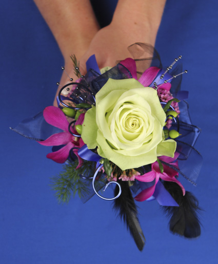 This fun prom bouquet features a single green rose with accents of fuschia flowers, purple ribbon, wire and feathers.]