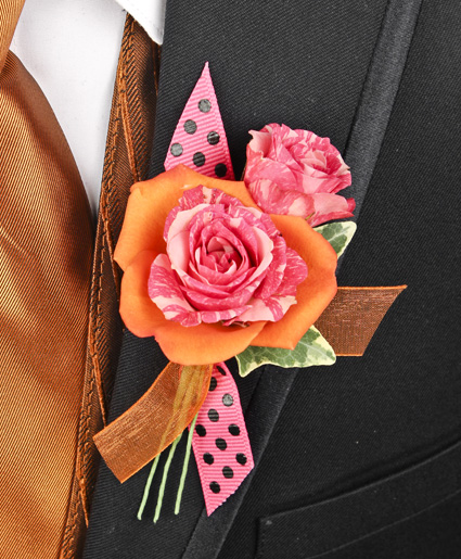 This orange and pink prom corsage features an orange flower with a pink flower inside of it to make a great contrast of colors. Plus, the added accent of the polka dot & orange ribbon makes it stand out.