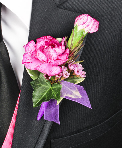 [Image: This colorful pink and purple prom boutonniere features a single pink flower with the accent of purple ribbon.  ]