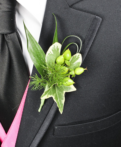 [Image: This prom boutonniere features the color green throughout every aspect.]