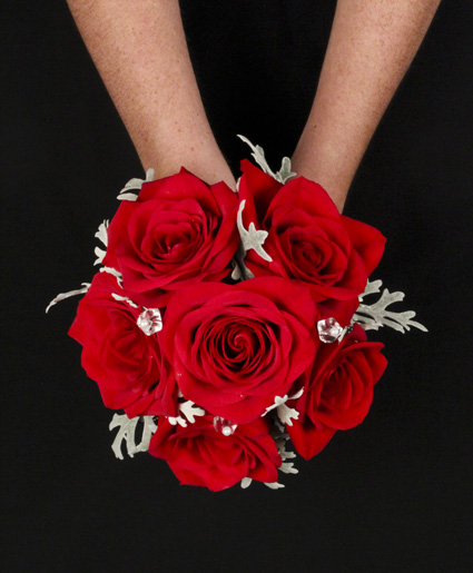 [Image: This beautiful red prom bouquet has great crystal accents that really pop against the red flowers.]