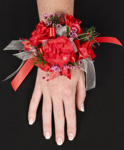 [Image: This red prom corsage features beautiful red flowers with red and white ribbon.]