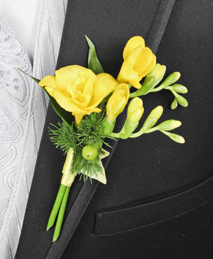 [Image: This yellow and green boutonniere features beautiful yellow flowers with hints of green accents. ]